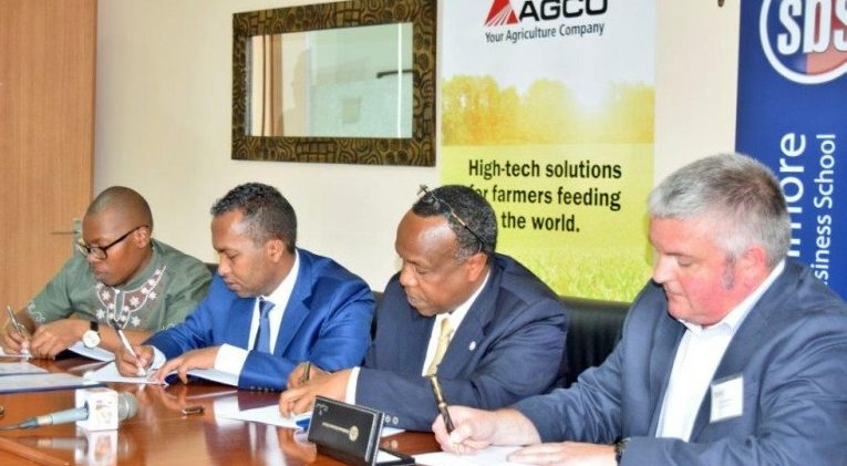 Simon Mwangi, CEO/Founder The Bridge Africa Group Ltd, Kenya; AGCO's Nuradin Osman; Dr George Njenga, Dean, Strathmore Business School and Dr Andy Wilcox, Head of Crop & Environment Science, Harper Adams University, UK, sign the MoU for AGCO Agribusiness Programme on September 25, 2017.